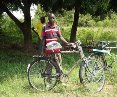 Onyait Michael with bicycle for web.jpg