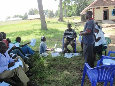 Uganda Project Officer Samuel Balamaga trains VHTs for web.jpg